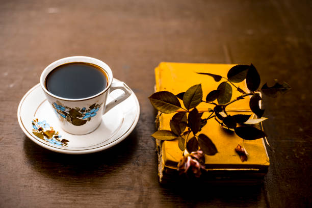An old book with a rose flower and a cup of coffee on tableconcept of picture id1048263708?b=1&k=6&m=1048263708&s=612x612&w=0&h=yxonqfkw3xjrsxhtuhc9tdt75hecz23 d8qhhc26e1a=