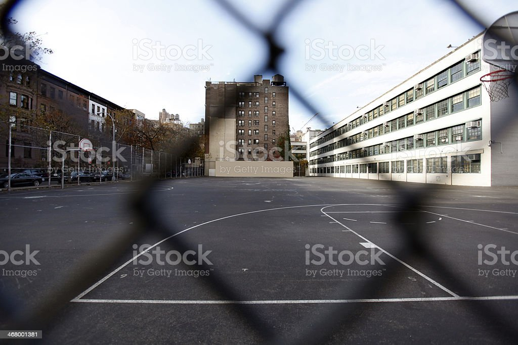 An old building behind a fence stock photo