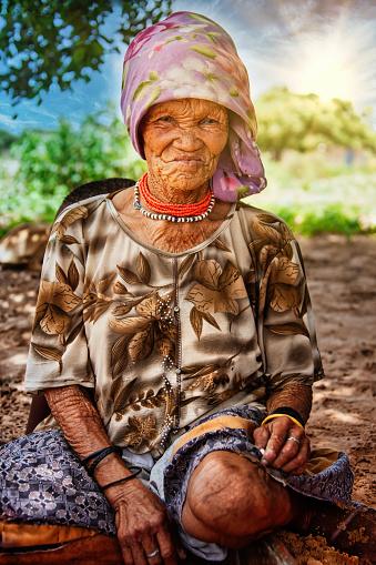 an old bushman woman from Central Kalahari, village New Xade in Botswana