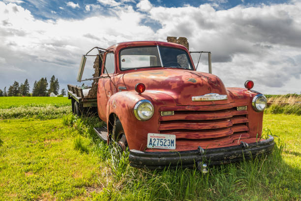 An old Chevrolet farm truck in a field in the Palouse hills. stock photo