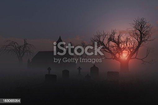 Scene of a church graveyard on a foggy sunset for Halloween.