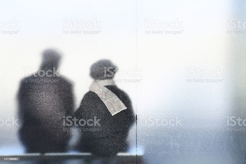 An old couple sitting together and enjoying each other royalty-free stock photo