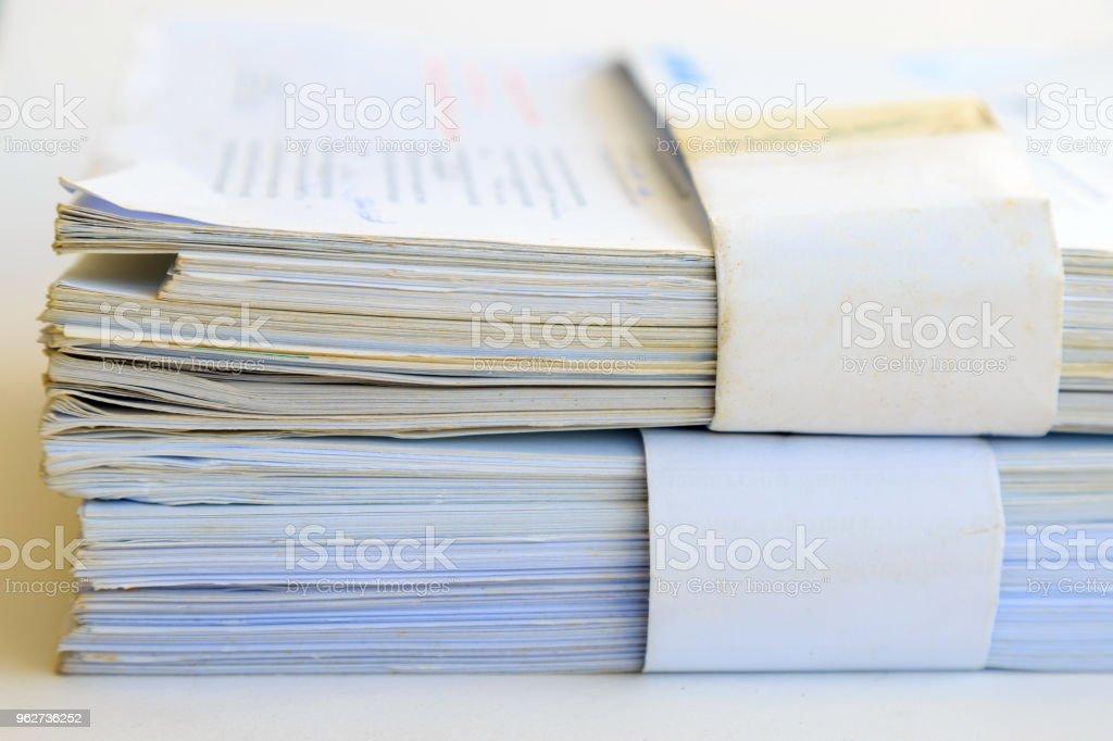 An old data sheet on white background. - Foto stock royalty-free di Affari