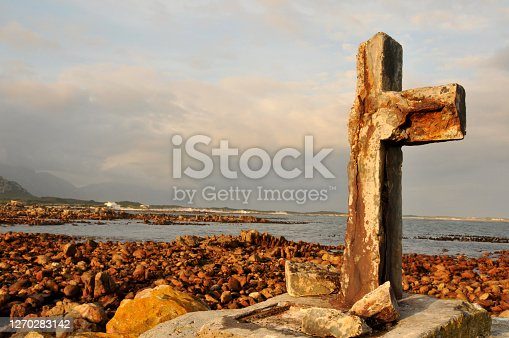 An old decomposing seafarer cross in False Bay South Africa commemorating sailors that died in the sea around the Cape of Storms