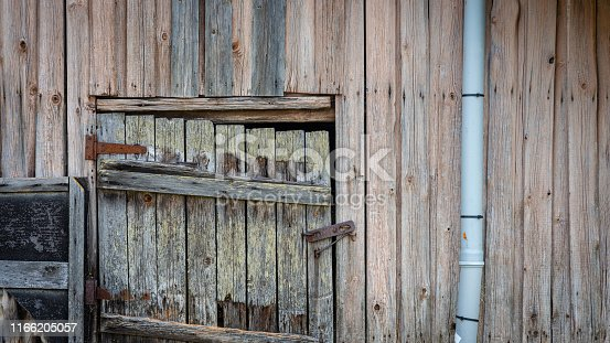 An old farmhouse cellar doors with locks.