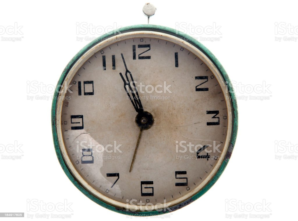 An old fashioned and worn out alarm clock royalty-free stock photo