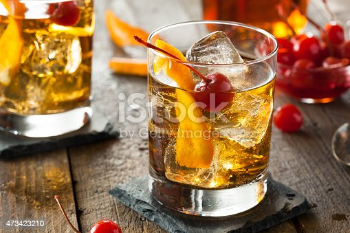 istock An old fashioned cocktail with cherries 473423210