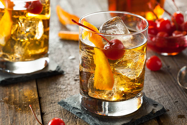 An old fashioned cocktail with cherries stock photo