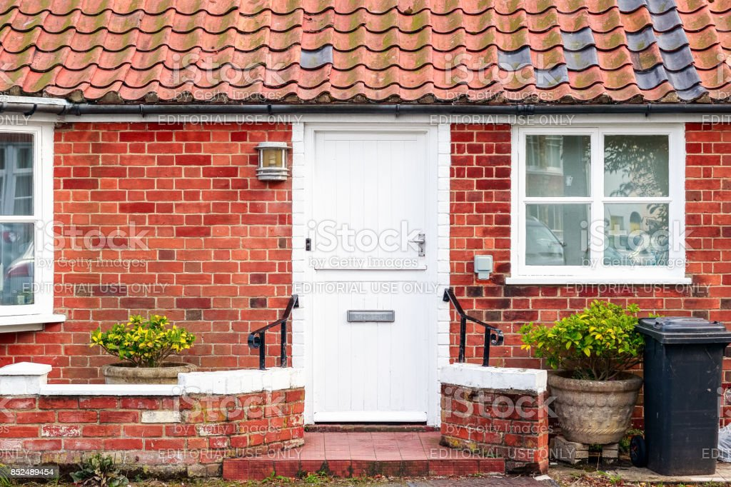 An old fashioned holiday brick cottage in Southwold, a popular seaside town in the UK stock photo