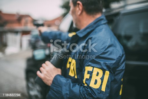 An old FBI agent uses a gun in action