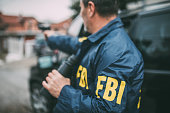 istock An old FBI agent uses a gun in action 1184832294