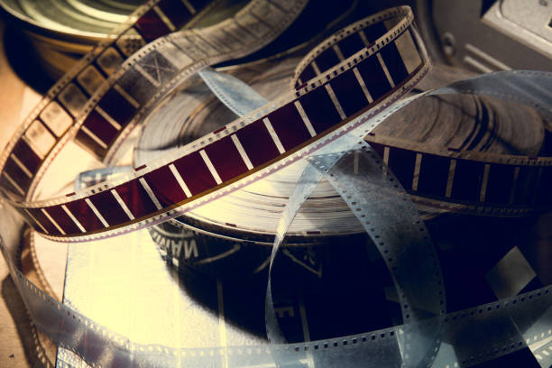An old film with a movie on the roll. stock photo