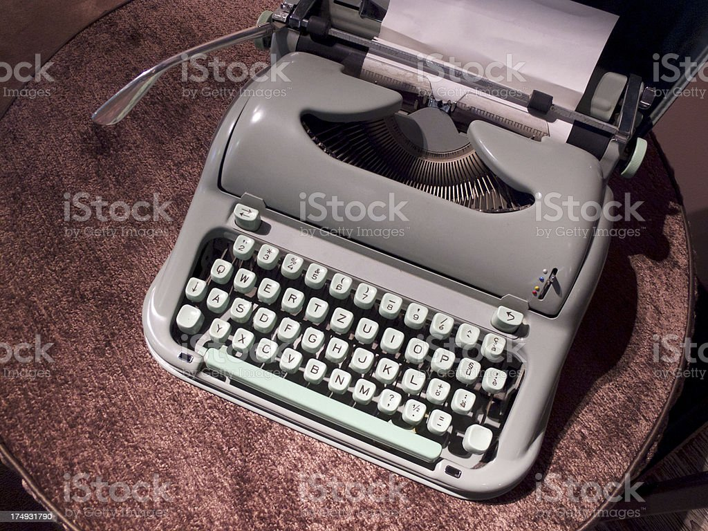 An old grey manual typewriter on a table royalty-free stock photo