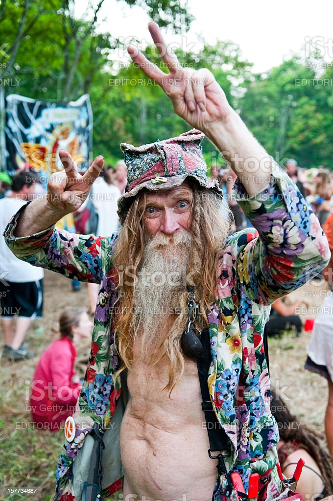 Old hippie and peace signs stock photo
