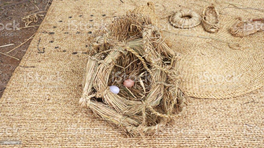 An old Korean traditional straw egg basket. zbiór zdjęć royalty-free