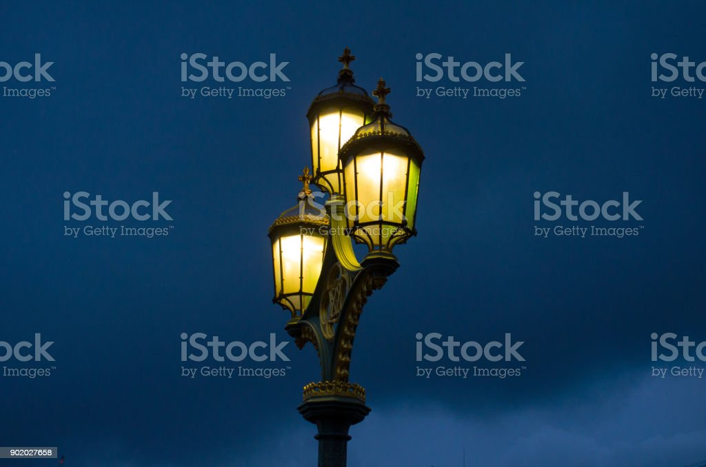 An Old Lantern Lit Up At Night Royalty Free Stock Photo