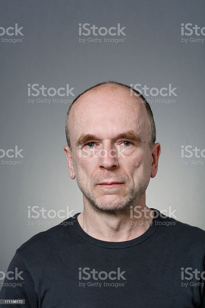 An old man looking into the camera stock photo