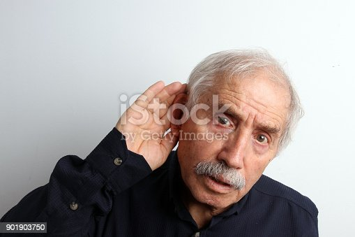 1029343276istockphoto An old man with hearing disabilities 901903750