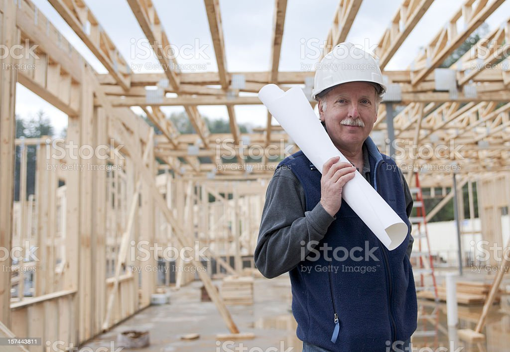 An old man working in a building in construction royalty-free stock photo