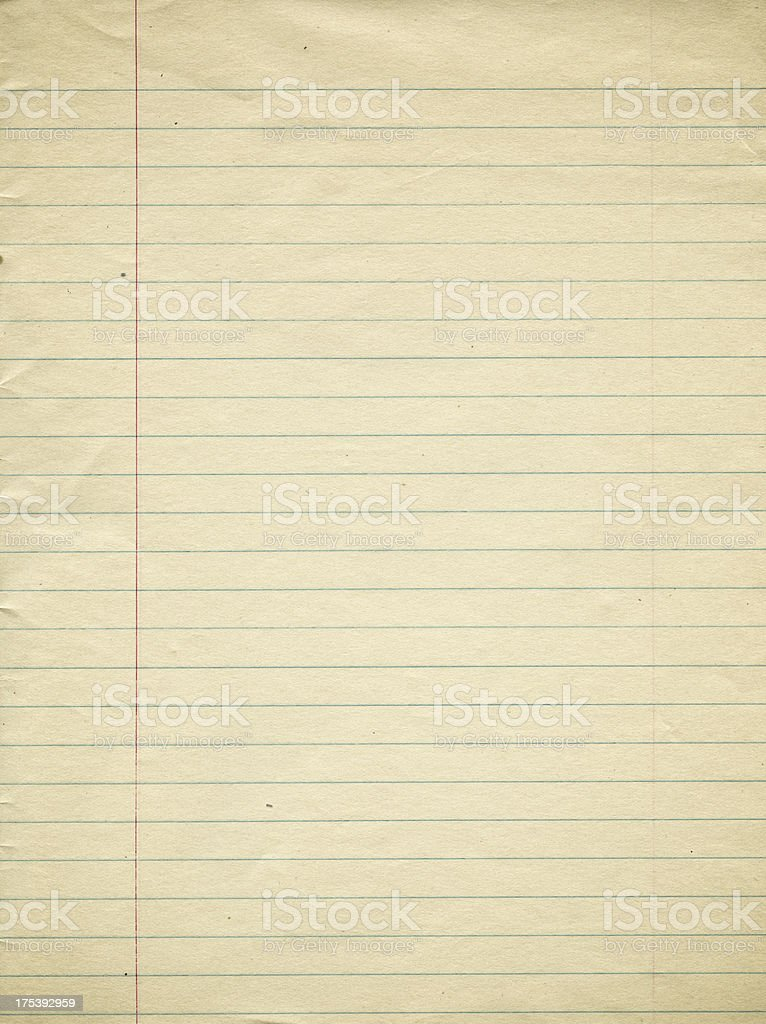 An old page of lined paper with red margin stock photo