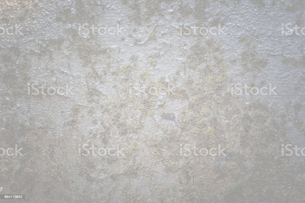 An old painted concrete monument wall without repair. Abstract natural pattern texture with cracking and multicolor peeling royalty-free stock photo