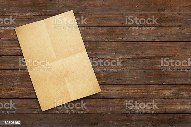 An Old Paper Letter Found On A Wooden Floor Stock Photo - Download Image Now