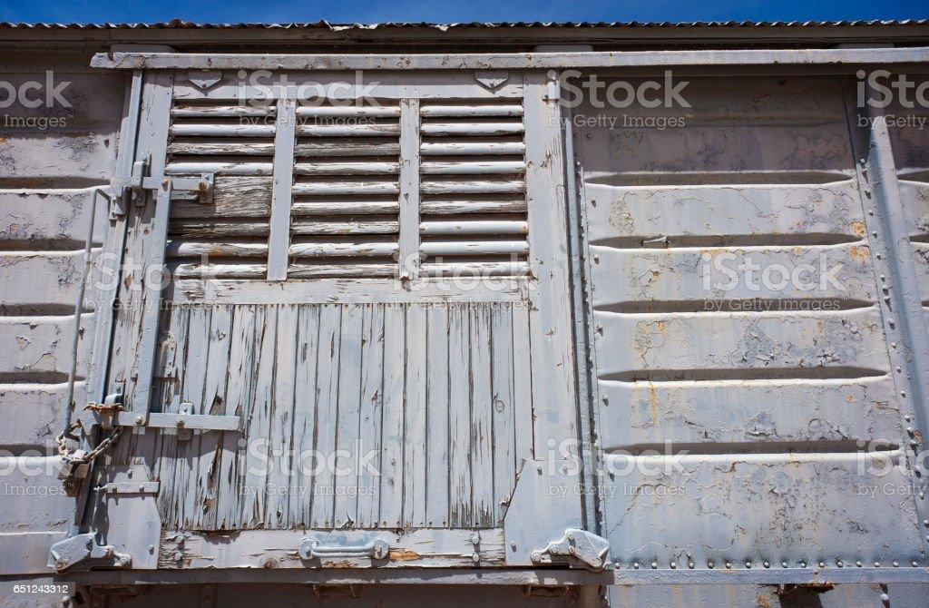 An old, peeling, rusty, sliding, white train door. stock photo