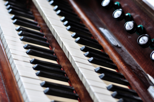An old pipe organ keyboard