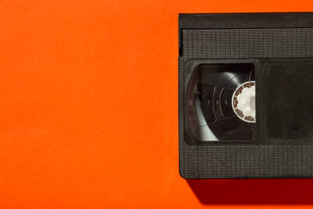 An old plastic video cassette for a film VCR against a bright background. stock photo