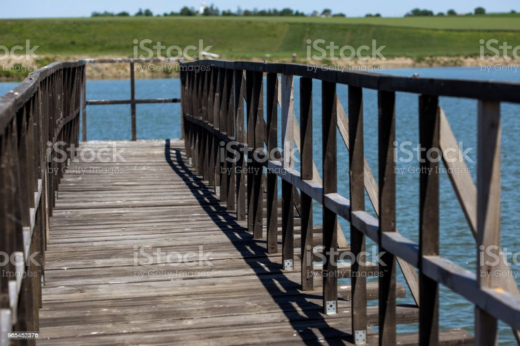 An old pontoon on a small lake in Romania royalty-free stock photo