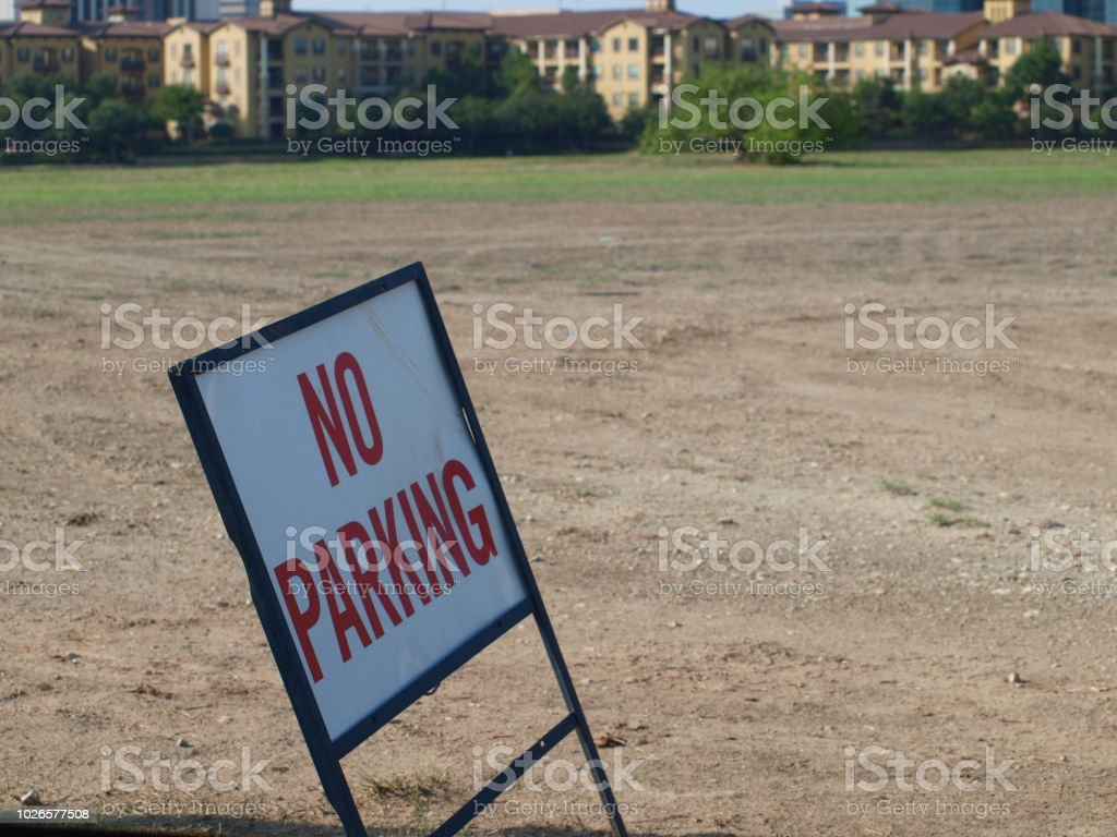 An old Real Estate Sign Used As No Parking stock photo