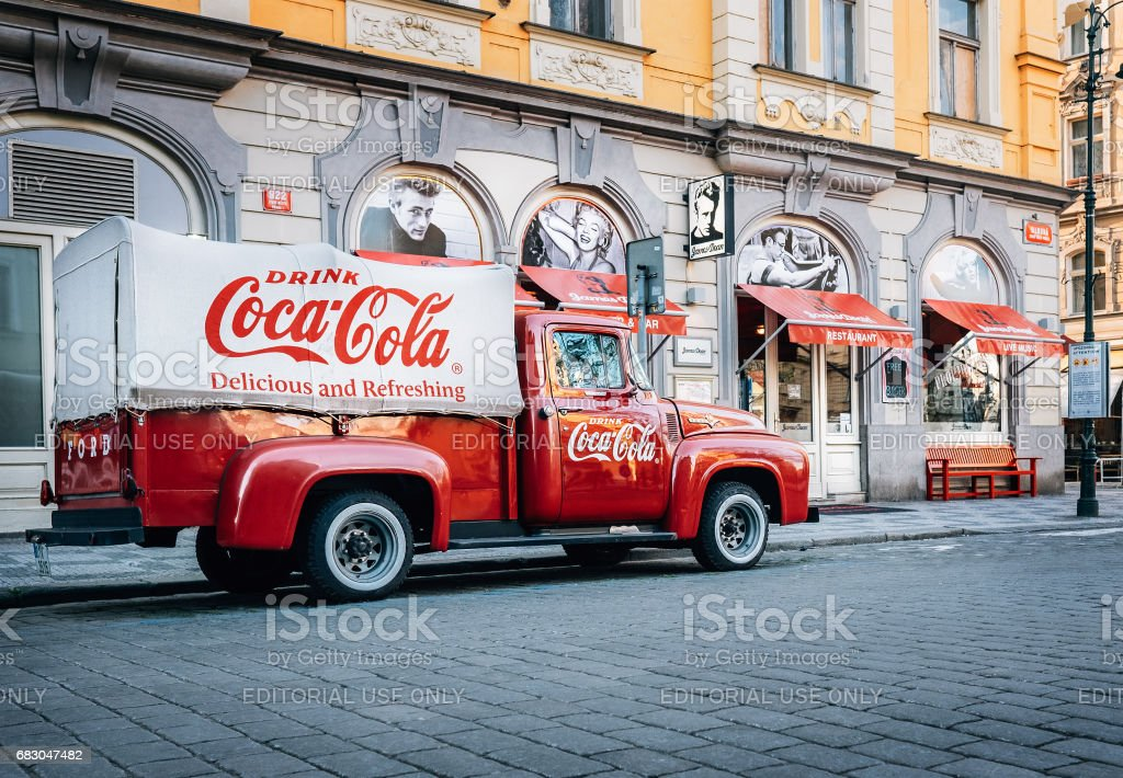An old renovated 1930 – 1940s  Coca-Cola red delivery pickup truck 1934 Ford parking on the Prague street  in Prague, Czech Republic - Photo