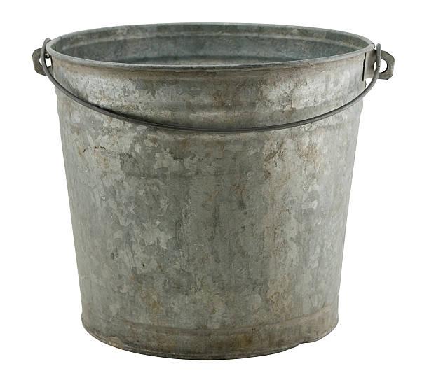 An old rusty farmers milk bucket stock photo