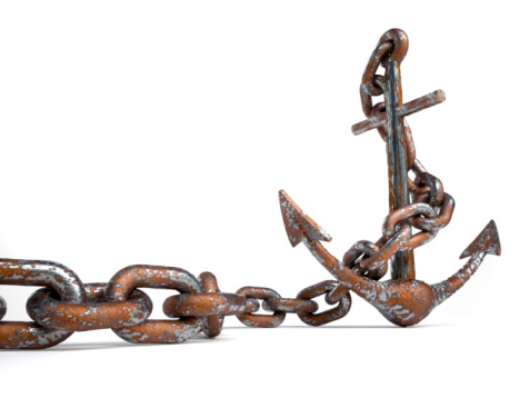 An old rusty iron anchor isolated on a white background