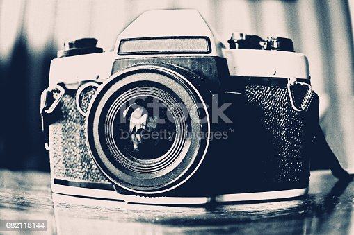 istock An old school 35mm camera. A traditional camera from when cameras were not digital. 682118144