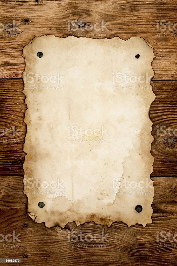 An old script paper nailed on wood stock photo