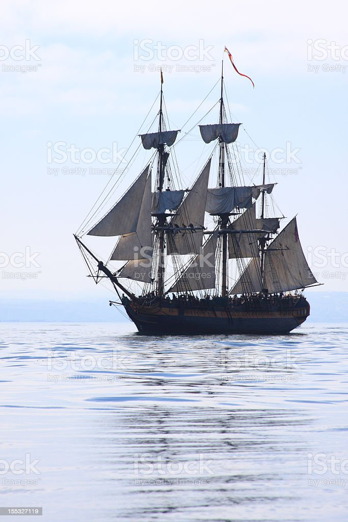 An old ship sailing in open water stock photo