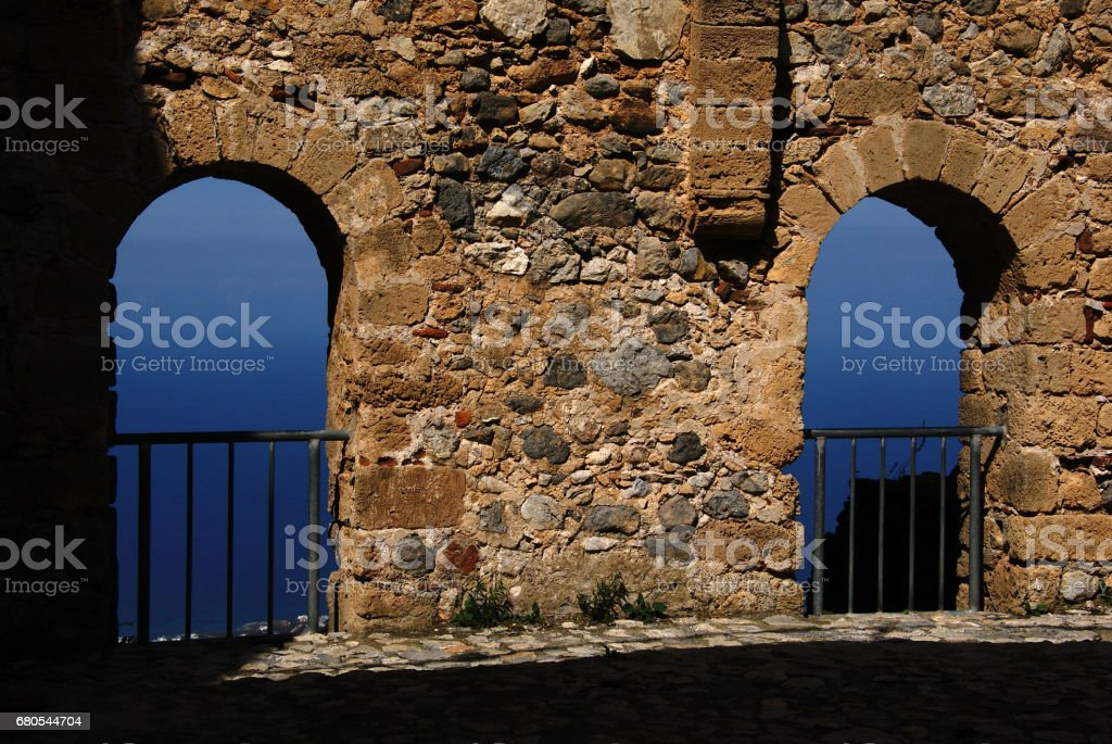 an old stone wall and gorgeous view of sea and sky on the backgorund stock photo