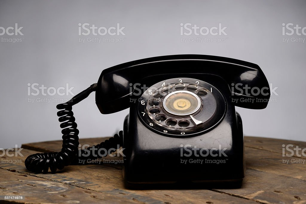An Old Telephone With Rotary Dial Stock Photo - Download