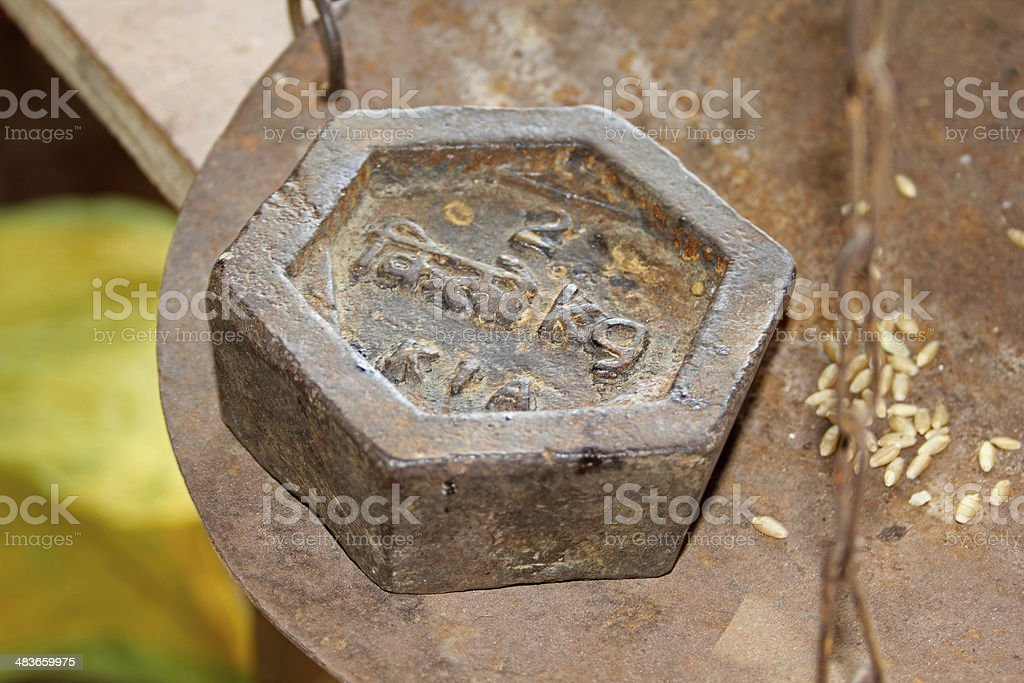an old two kg hexagon shaped weight at indian market stock photo