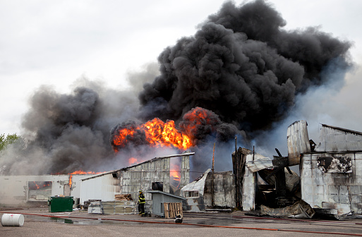 Building engulfed in smoke and fire.