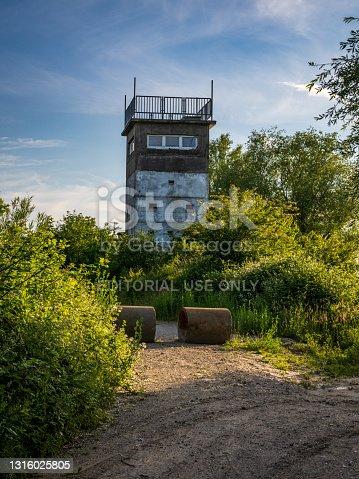 Schwanbeck, Mecklenburg-Western Pomerania, Germany - June 16, 2020: A derelict watchtower near Dassow