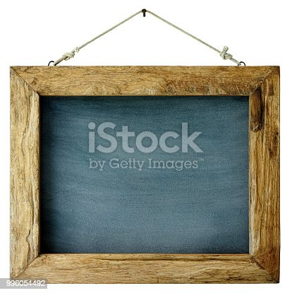 An old weathered framed blackboard hangs from a rusty nail, isolated on white, clipping path included. Good copy space with lots of rustic character.