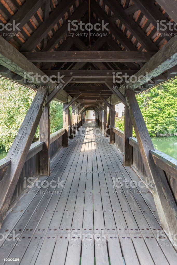 An old wooden bridge in the old town of Nuremberg, Germany during day stock photo