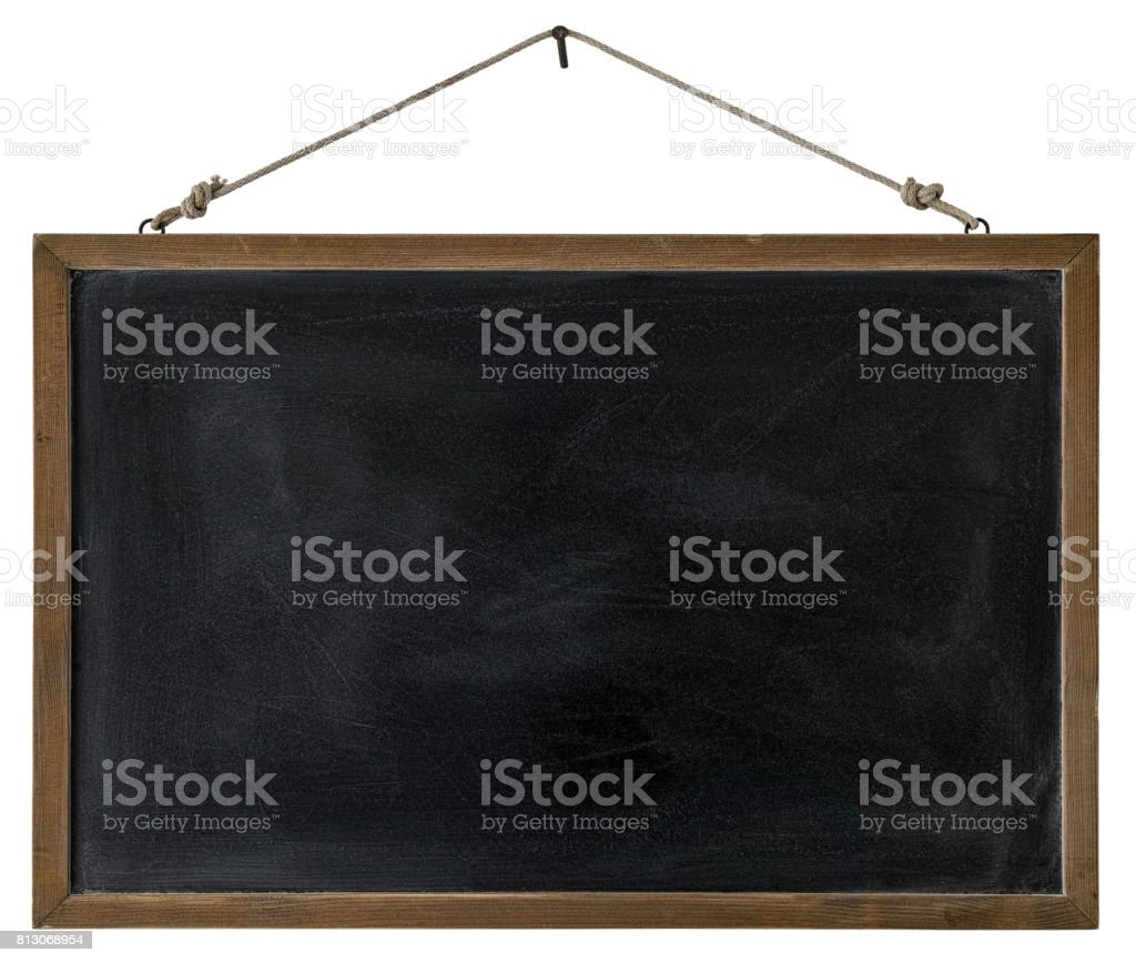 An old wooden framed blackboard hangs from a rusty nail, isolated on white, clipping path included. stock photo