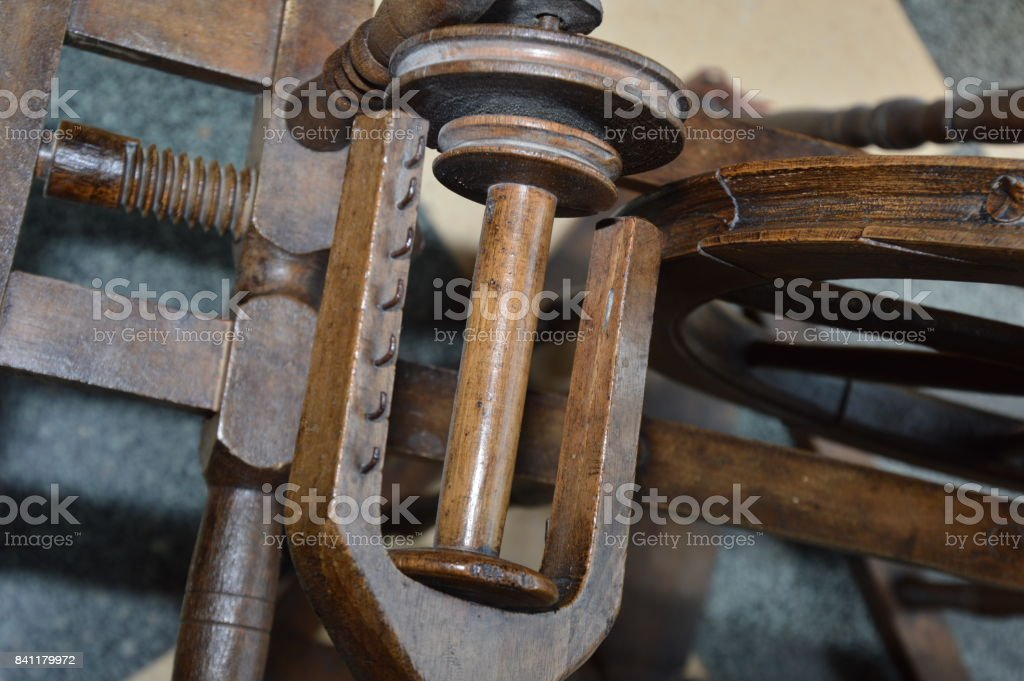 An old wooden spinning wheel stock photo