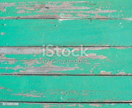 An old wooden wall of boards with peeling paint. Beautiful unusual background.