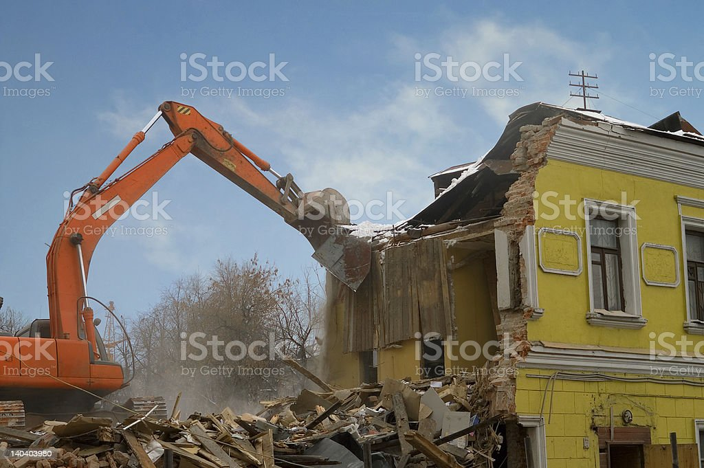 An old yellow house being demolished royalty-free stock photo