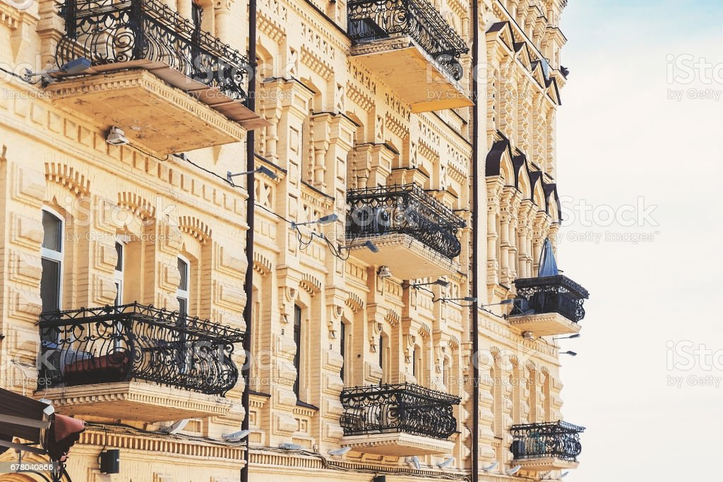 An old yellow house with wrought-iron balconies stock photo