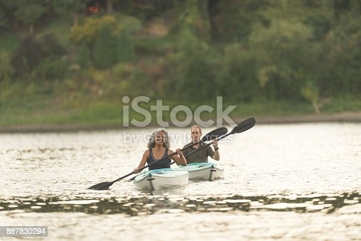 690538774 istock photo An older couple enjoy a late evening of kayaking on the river 887830294